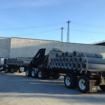Concrete Retaining Walls, Blocks & Barriers | Train & Transportation Company | Can Ridge Industries Ltd. Unit 11 Folding Boom Mobile Crane hauling pre-cast concrete pipes
