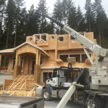 Concrete Retaining Walls, Blocks & Barriers | Train & Transportation Company | Can Ridge Industries Ltd. Landing Trusses on a New Home Build