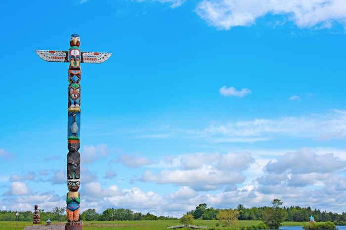 A large totem pole that needs to be relocated with industrial moving