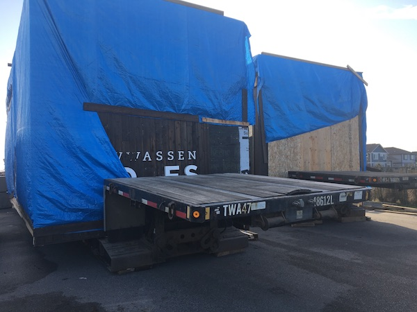 Several modular homes being moved by the logistical team at Can Ridge in Vancouver