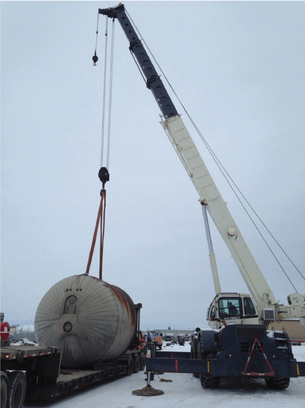 Can Ridge crane lifting autoclave off truck in Alberta